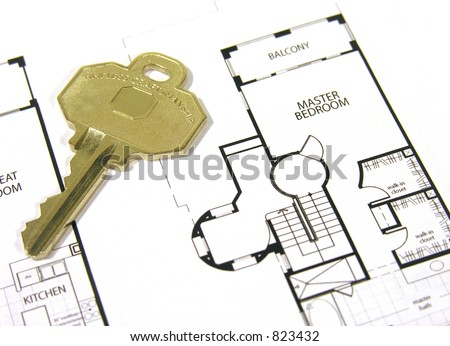 A photo of a new home key on top of home plans