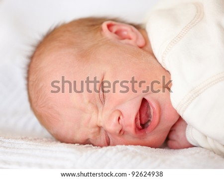 A photo of a Newborn baby crying