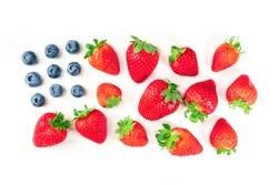 A photo of a representation of the American flag, made up by blueberries and strawberries on a white background. A culinary Independence Day greeting card, 4th of July banner