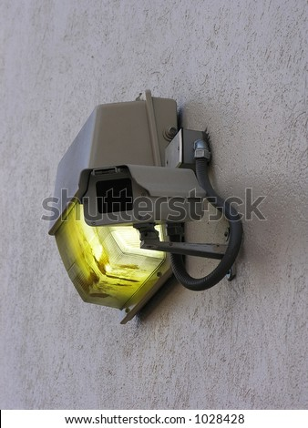 A photo of a security camera on a wall