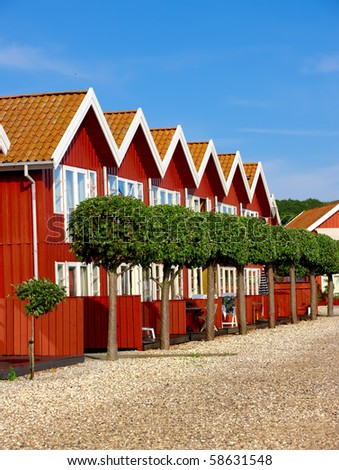 A photo of a series of red houses by the sea (Denmark)