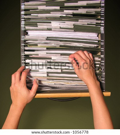 A photo of a woman filing