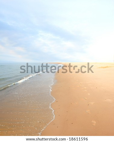 A photo of beach and ocean in sunset