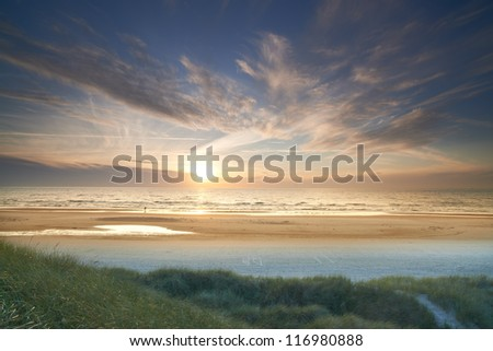 A photo of beach sunrise - Jutland, Denmark - stock photo