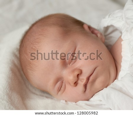 A photo of beautiful baby girl sleeping
