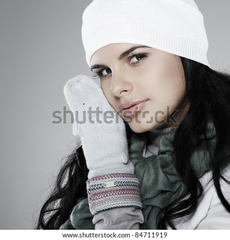 A photo of beautiful girl is in winter clothes - stock photo