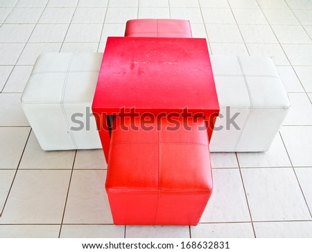 a photo of cube chair and table at living room