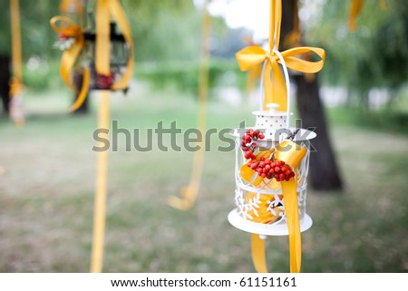 A photo of decorated wedding tree and candles