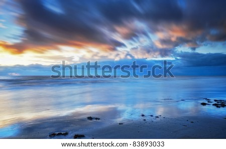 a photo of dramatic ocean sunset