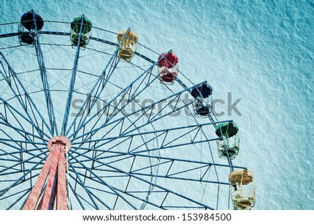 a photo of ferris wheel in vintage style,textured