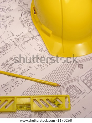 A photo of home plans with construction tools
