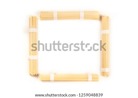 A photo of individually wrapped portions of udon noodles, shot from above, forming a frame on a white background with a place for text
