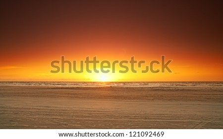 A photo of ocean sunset, the coast of Jutland, Denmark - stock photo