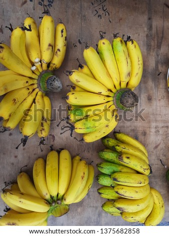 A photo of riped banana sells in early morning stall in Malaysia. #1375682858