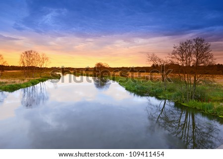 A photo of river landscape in sunset