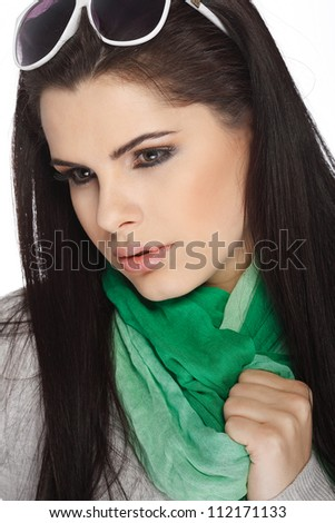 A photo of sexual  beautiful girl in a green scarf is in fashion style isolated on a white background