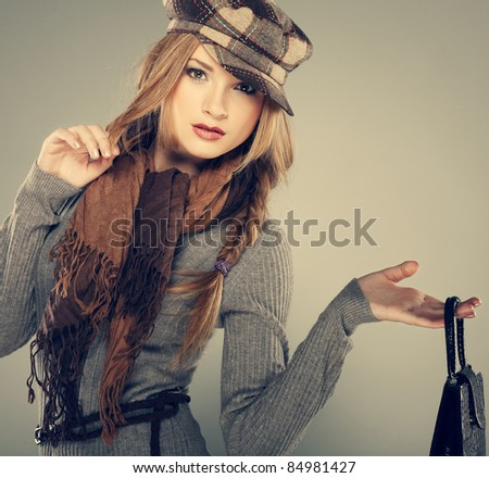 A photo of sexual  beautiful girl is in fashion style with a bag