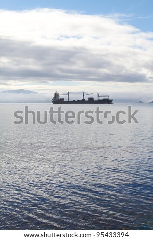 A photo of ship, Sunset, ocean and mountains