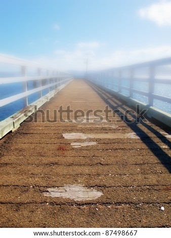 A photo of Small bridge and water - morning fog