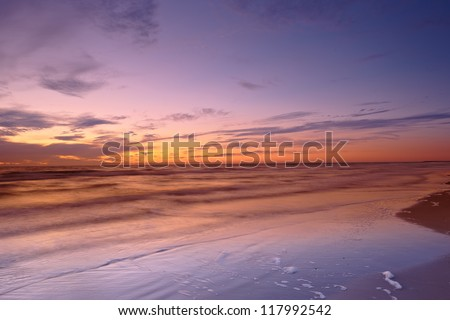 A photo of sunrise at the beach