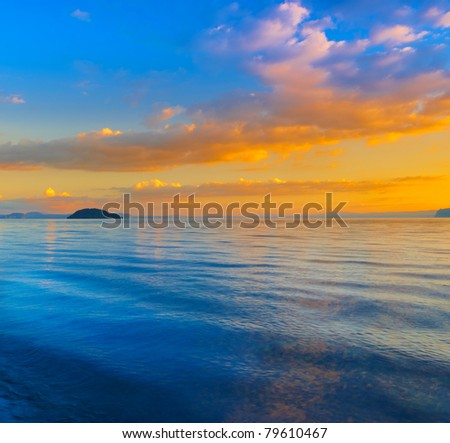 A photo of Sunset a calm day by the sea in New Zealand