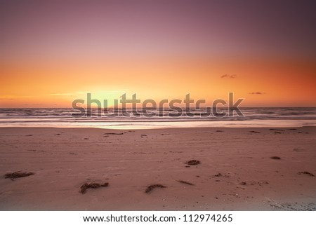a photo of sunset and beach - stock photo