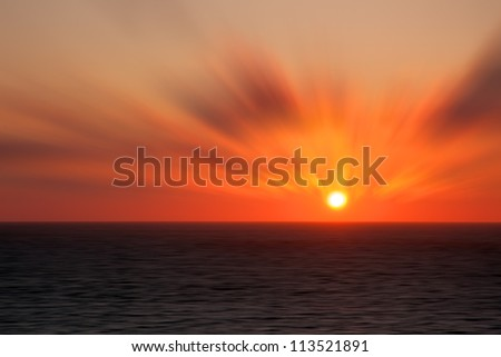 A photo of sunset at sea with a photo effect