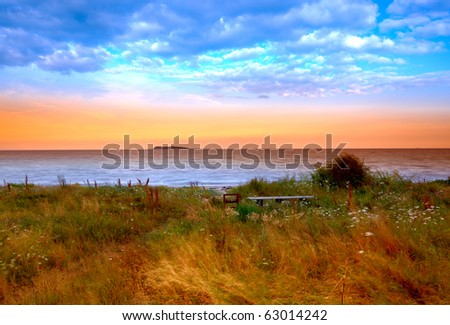 a photo of Sunset by the ocean - Denmark - stock photo