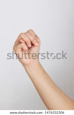 a photo of the M alphabet sign language symbol for the speech impaired