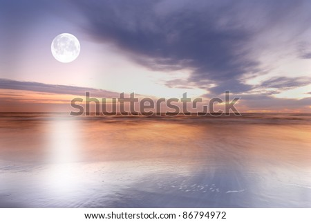 a photo of the moon at the beach