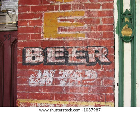 A photo of the outside of an old bar - stock photo
