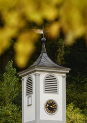 A photo of the top of a clock Tower showing a clockface