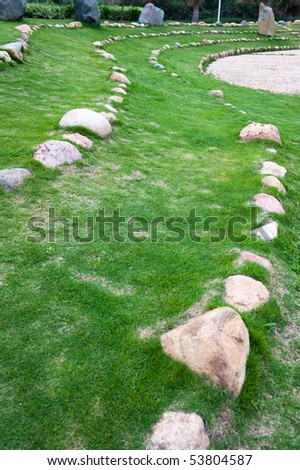 A photo of tracks separated by many stones.