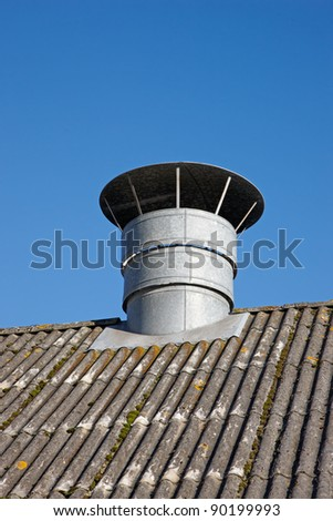 A photo of ventilation on a roof of a farm house