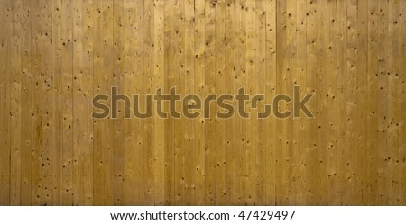 A photo of vertical wood background  planks stacked making a nice background.