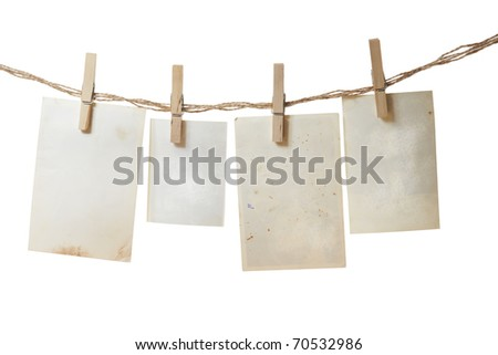 a photo pages on the rope with clothespins on white