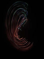 A photo taken by the camera in free flight, Bright colored lines and figures on black. Flyfly. Camera toss image