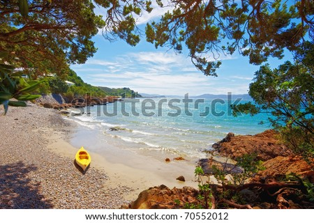 a photograph of a yellow kayak on the beach