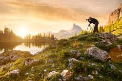 A photographer in the beautiful lake Federa