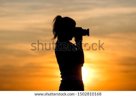 a photographer woman sundown shadow #1502810168