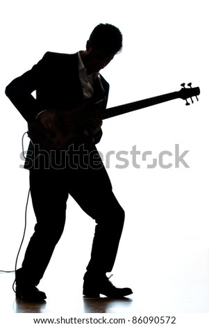 A photographic silhouette of a Bass Guitar Player