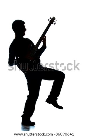 A photographic silhouette of a Guitar Player