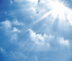 A photography of a blue sky with sun rays
