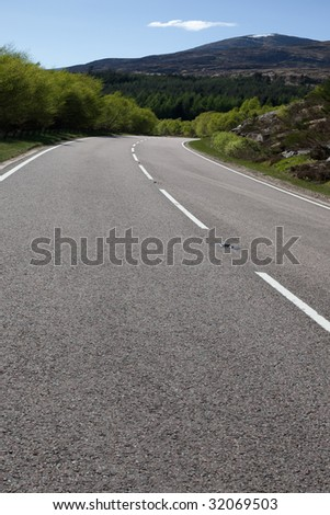 A photography of a road in the scottish highlands