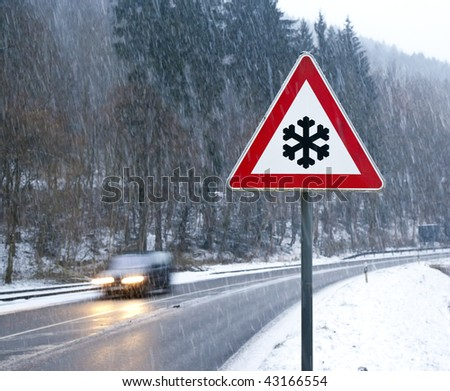 Stock Photo A photography of a snow street sign