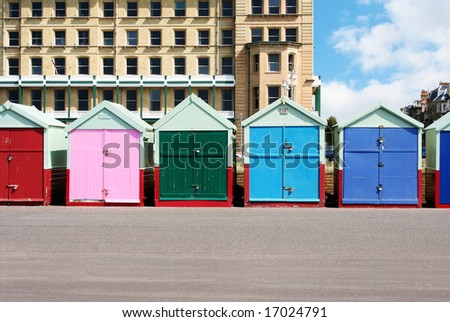 A photography of colorful houses at the beach in Brighton