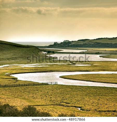 A photography of river going to the sea - stock photo