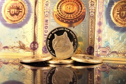 A physical version of Dogecoin (Cryptocurrency) in the form of coin and Bitcoin banknotes. A conceptual image for investors in the fast-growing cryptocurrency and blockchain technology market.
