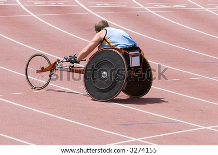 A physically handicapped athlete on the running track in a specially constructed wheelchair