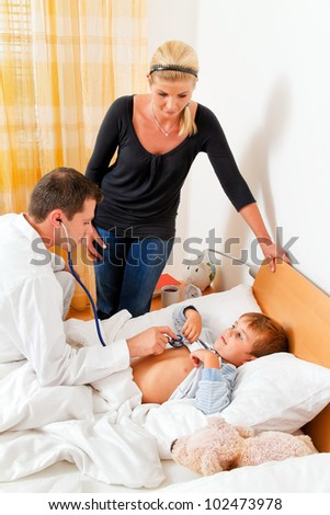 a physician house call. examines a sick child.